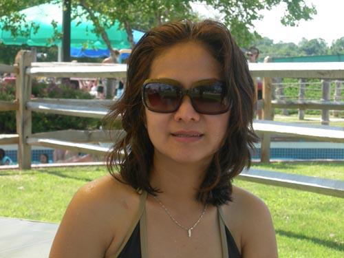 Asian American woman in swimming pool
