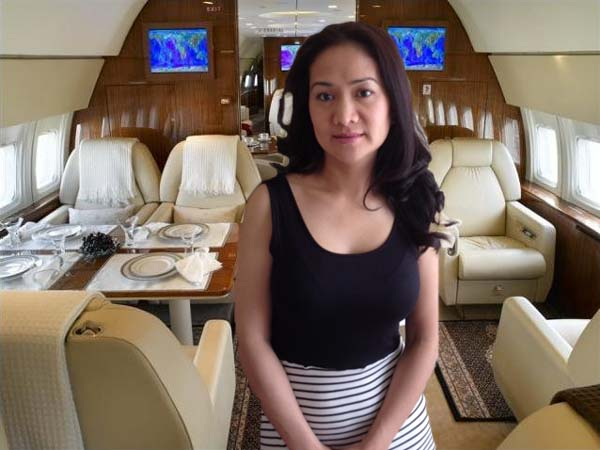 Rich Chinese woman in a private jet
