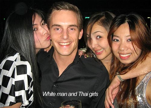 White man and Thai girls