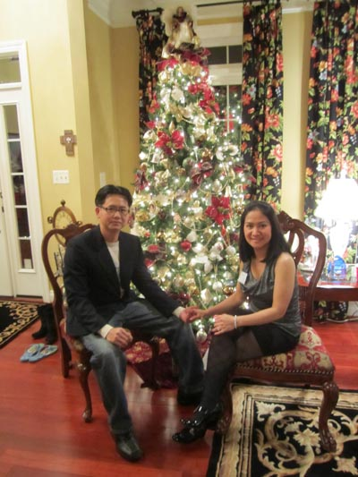 Chinese woman n man at Christimas tree