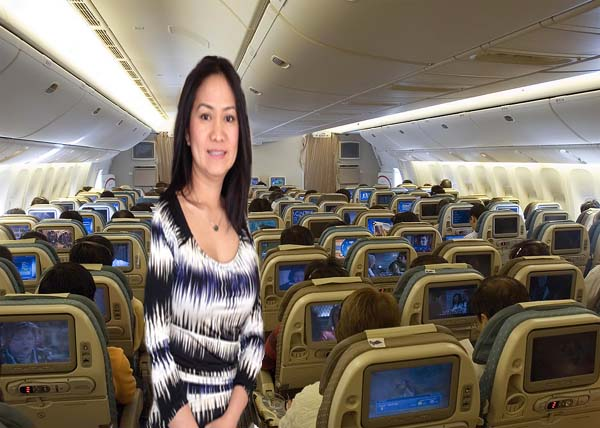 Asian woman in Singapore Airplane
