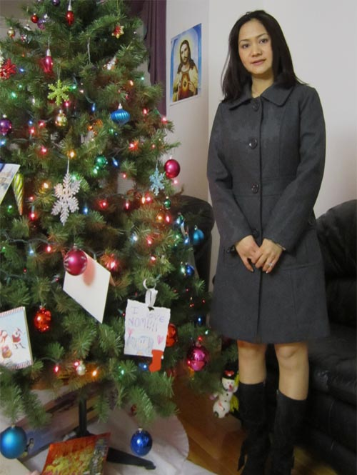 Singapore woman at Christmas tree
