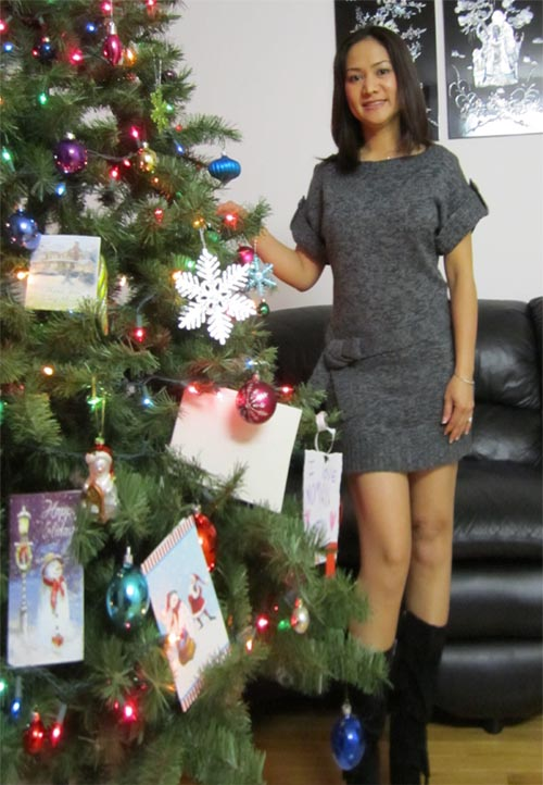 Singaporean woman n Christmas tree